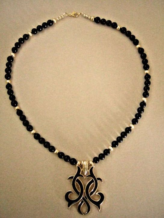 Black Enamel and Gold Ornate Pendant Necklace, Hand Beaded with Black Onyx and Gold Plated Ornate Beads