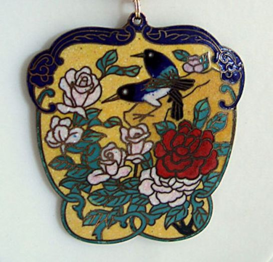 close up of floral bird pendant