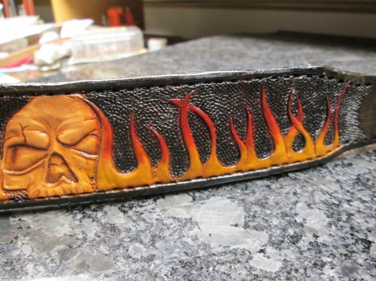 Custom tooled leather dog collar from acrossleather with flames and skull tooled.