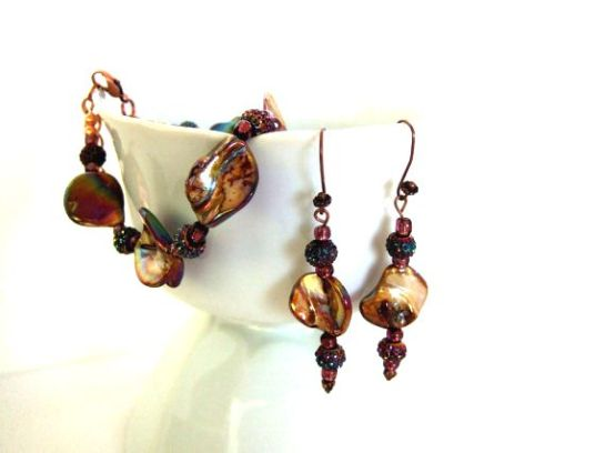Bronze bracelet and earrings lighter